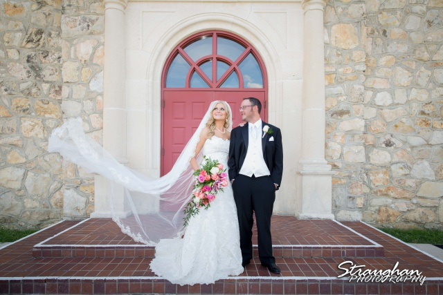 Kelley wedding St Peter's Boerne watching the veils