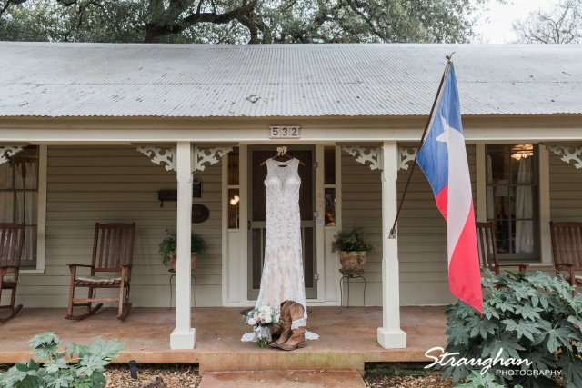 Kristin wedding Gruene Estates dress hanging at the house
