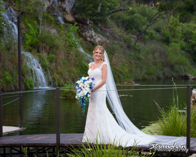 Karissa's bridal portraits the Lodge a Bridal Veil Falls on the bridge