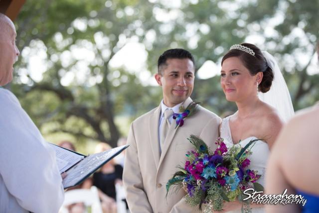 Kristan's wedding Bella Springs Boerne lookingat bride