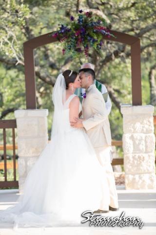 Kristan's wedding Bella Springs Boerne cross ceremony  kiss
