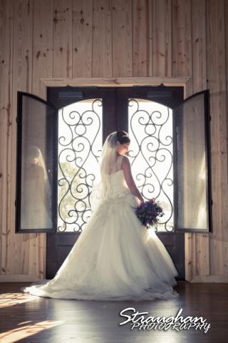 Kristan's Bridal sitting Bella Springs in the door way vintage