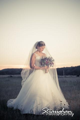 Kristan's Bridal sitting Bella Springs veil over her