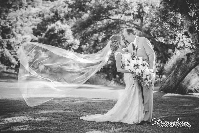 Tyler and Karissa's wedding kissing couple portrait