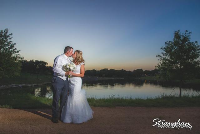 Loretta and Andrew's Wedding sunset kiss