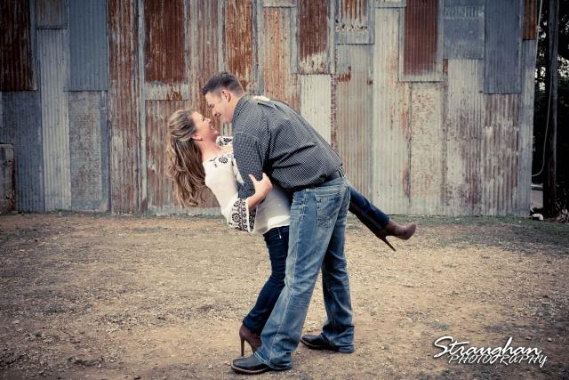 Leeann engagement Gruene tin wall kiss