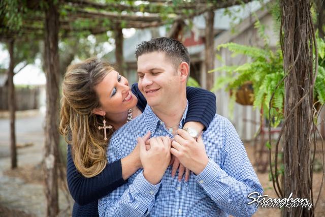 Leeann engagement Gruene in archway kiss