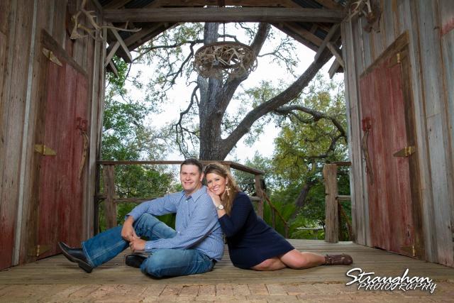 Leeann engagement Gruene sitting in antler roo,