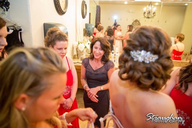 Logan's wedding Bella Springs Boerne TX mom watching getting dressed