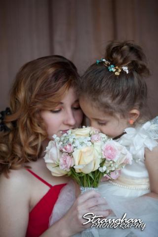 Logan's wedding Bella Springs Boerne TX smelling the flowers