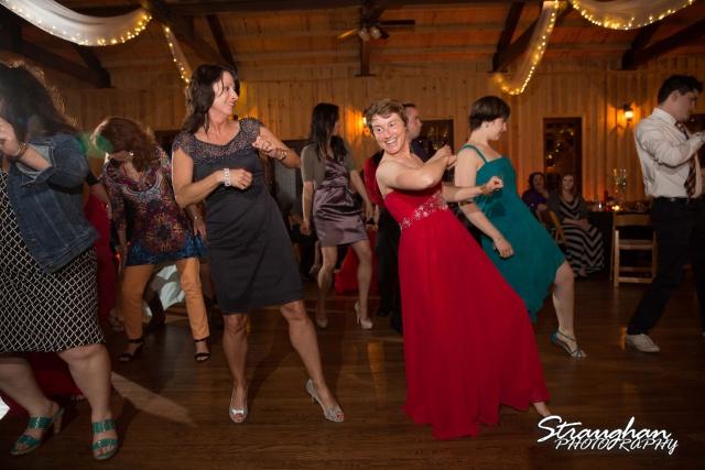 Logan's wedding Bella Springs Boerne TX mom and sis dancing
