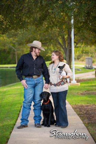 Lauren and Micah engagement on path with dogs