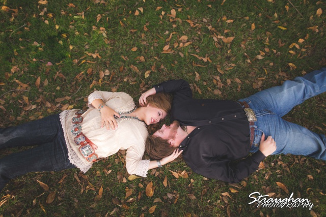 Lauren and Micah engagement in the grass