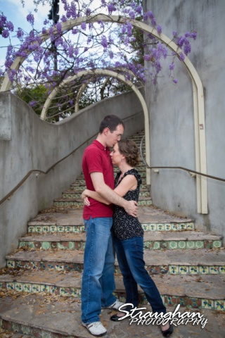 Laura and Ryan engagement downtown San Antonio with wisteria