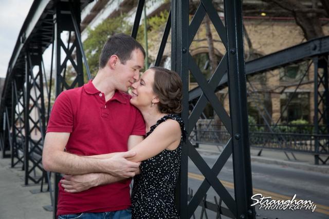 Laura and Ryan engagement downtown San Antonio iron bridge kiss