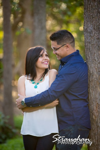Luz Anniversary shoot Gruene hugging by tree