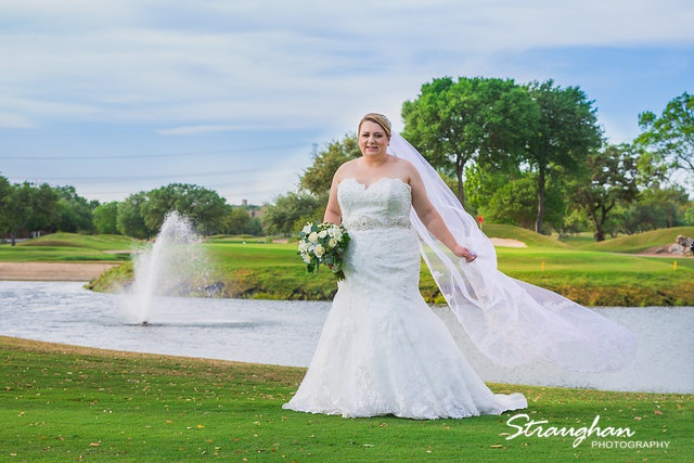 Megan Cole Bridal Club at Sonterra in front of the fountain