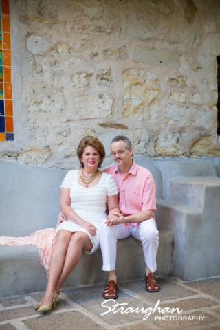 Cameron engagement on the riverwalk stone wall