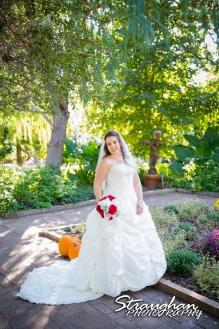 Michelle Bridal San Antonio Botanical Gardens standing by pumpkin