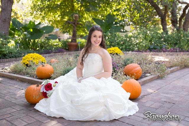 Michelle Bridal San Antonio Botanical Gardens sitting with pumpkins