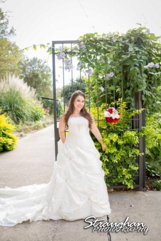 Michelle Bridal San Antonio Botanical Gardens at gate looking