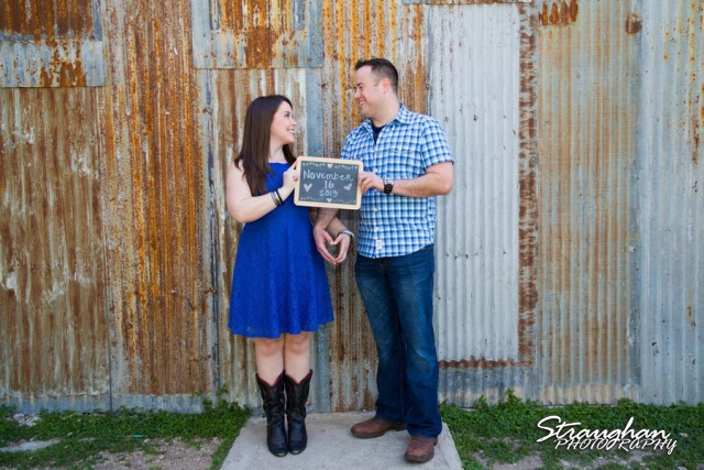 Michelle's engagement in Gruene against tin wall