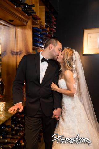 Michelle wedding Houston Ousie's wine cellar kiss