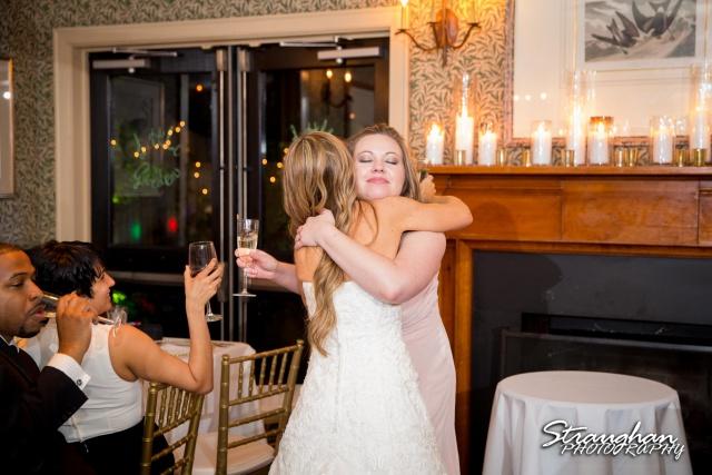 Michelle wedding Houston Ousie's sister hug