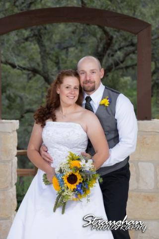 Monica wedding Bella Springs couple at arch