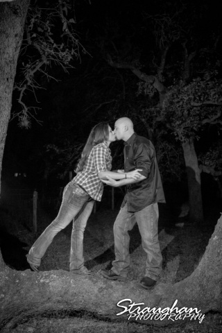 Monique's engagement Seguin kissing in tree bw