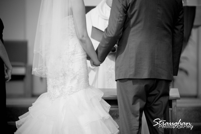 Alexis wedding St Luke's Catholic Church hands