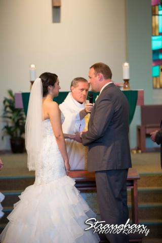 Alexis wedding St Luke's Catholic Church ring exchange