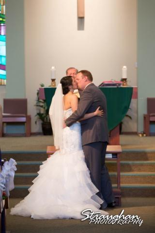 Alexis wedding St Luke's Catholic Church kiss