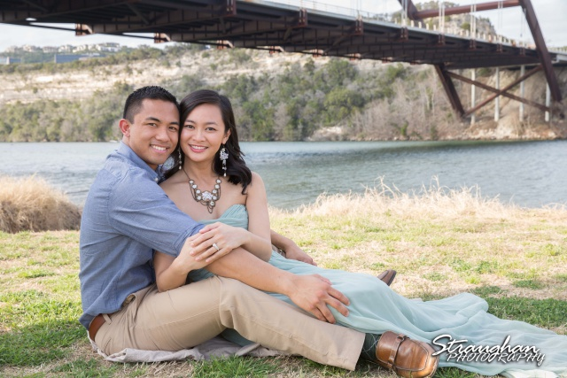 Rynah engagement Austin sitting under the bridge