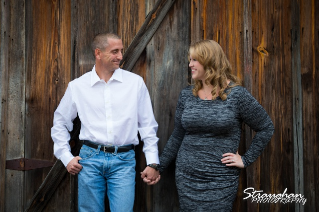 Rhonda engagement sitting Gruene on wooden wall far