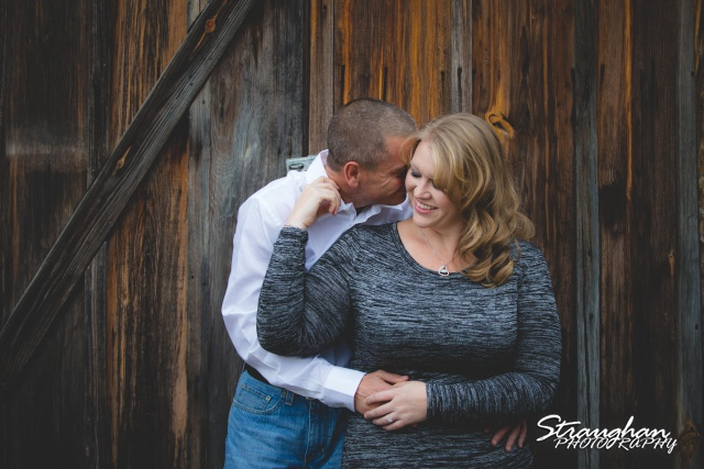 Rhonda engagement sitting Gruene on wooden wall tonal