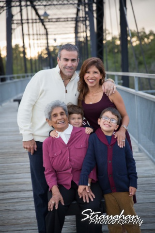 Raimondo family sitting Faust street Bridge with grandma