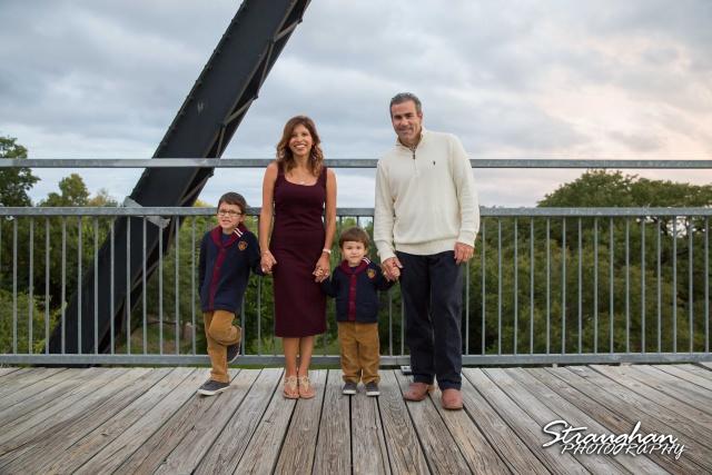 Raimondo family sitting Faust street Bridge rainbow clouds