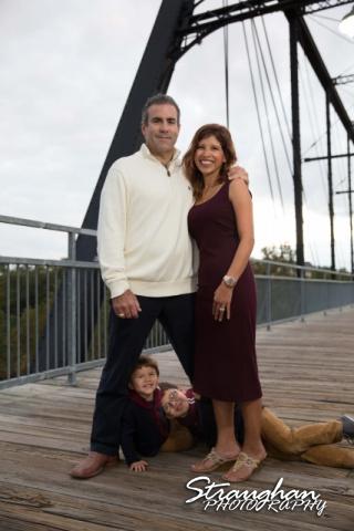 Raimondo family sitting Faust street Bridge mom and dad standing
