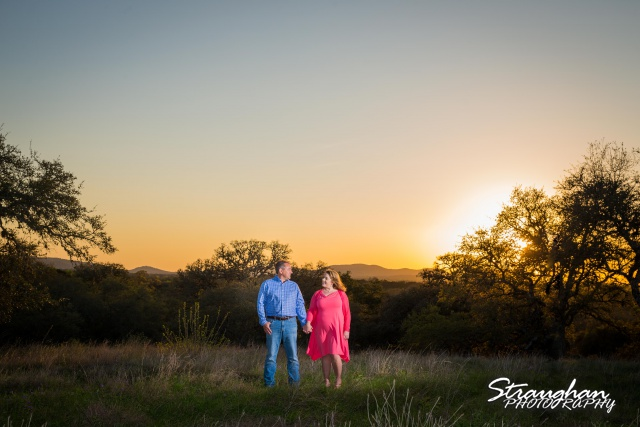 Rebecca and Perry's Engagement walking into the sunset