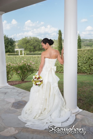 Rynah bridal Gardens of Cranesbury View back of dress by column