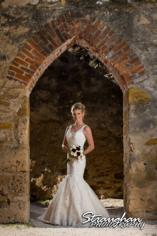 Sarah Higley Bridal Mission San Jose in arched doorway
