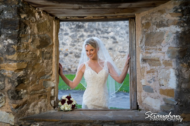 Sarah Higley Bridal Mission San Jose framed in window