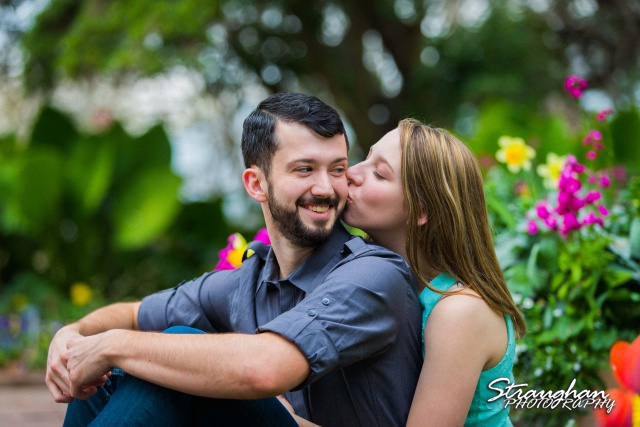 Skylar Engagement San Antonio Botanical Gardens her kiss him