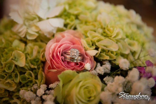 Sarah and Ryan Faithville wedding rings in flowers