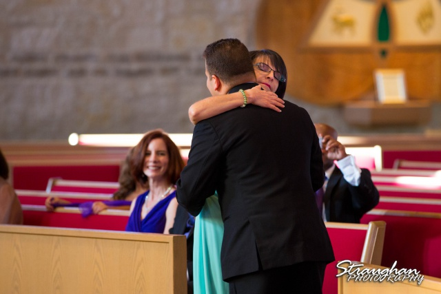 Stephanie wedding Holy Trinity Church moms hug