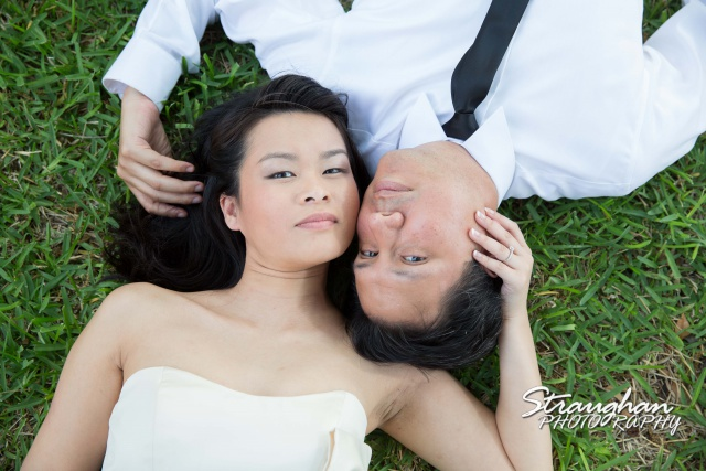 Thoa engagement New Braunfels Faust laying in the grass