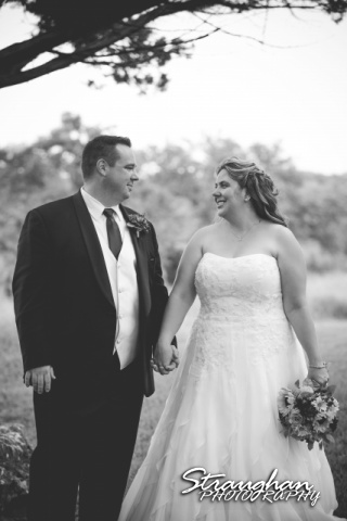 Jeanette wedding Boulder Springs Stonehaven bw holding hands