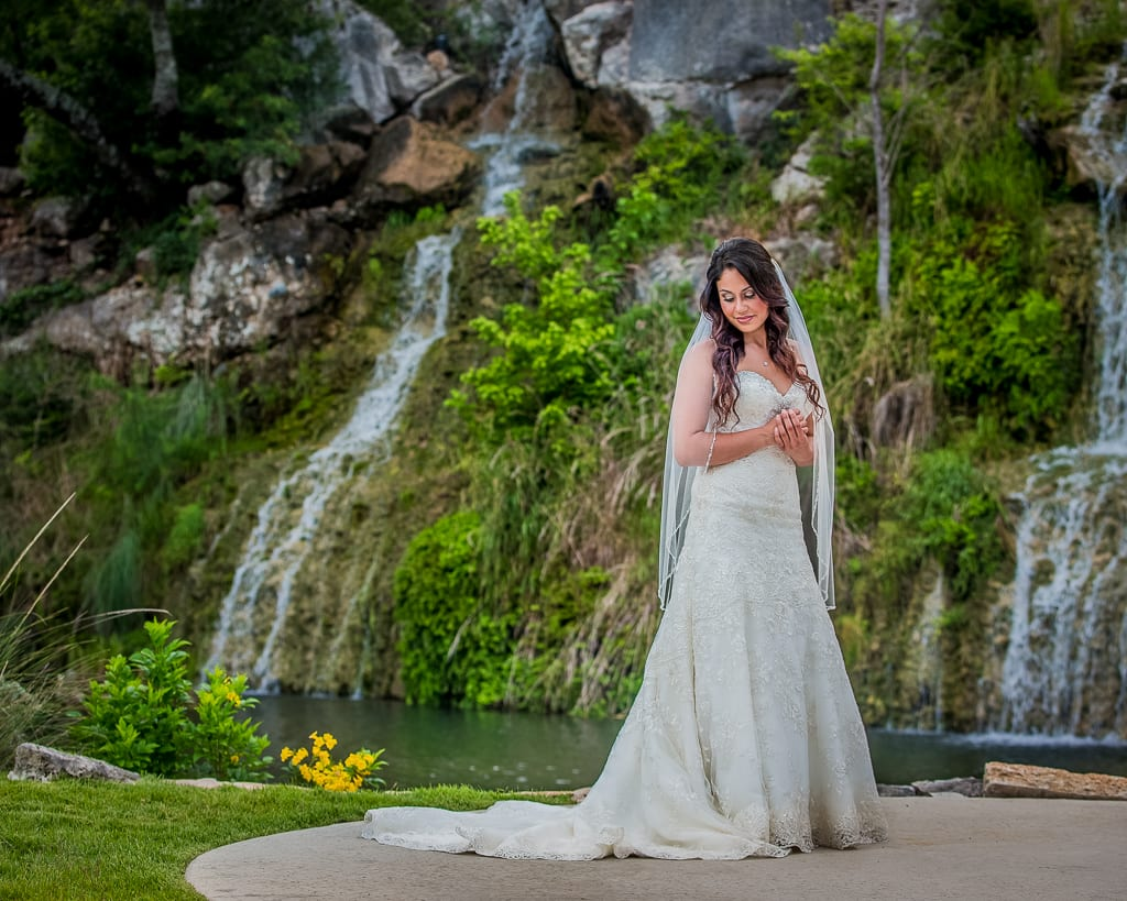 bridal photos with waterfall on the background