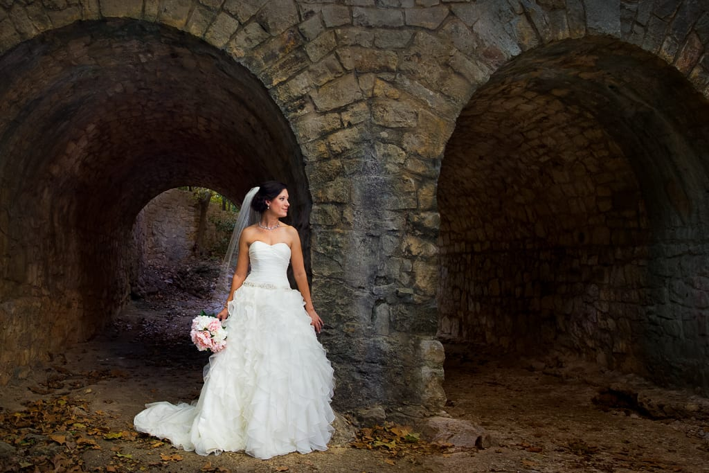 bridal photos on bridge arches